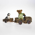 Bear Pulling Dog in Cart